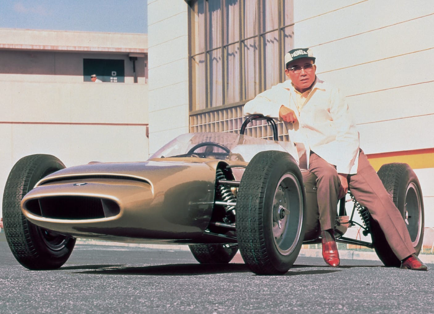 Soichiro Honda with Honda vehicle